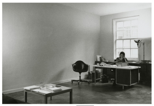 "Installation view of the exhibition, ""January 5-31, 1969"" with work by Lawrence Weiner (desk, receptionist with the catalogue). January 5, 1969 through January 31, 1969. Rented office space, 44 East 52 Street, New York, New York. Seth Siegelaub Archives. Gift of Seth Siegelaub and the Stichting Egress Foundation, Amsterdam. The Museum of Modern Art Archives, New York."